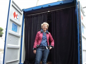 artist in front of shipping container